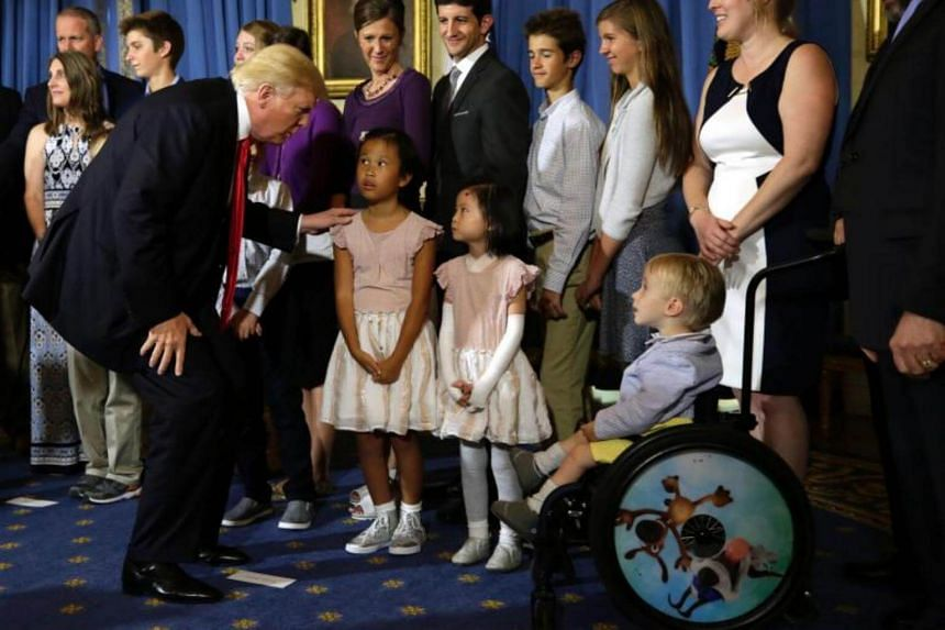 US President Donald Trump speaking to children after delivering a statement at the White House on July 24, 2017.