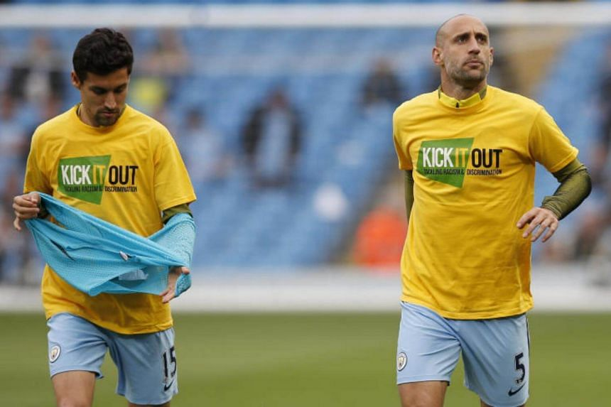 Manchester City's Jesus Navas (left) and Manchester City's Pablo Zabaleta warm up before the match.