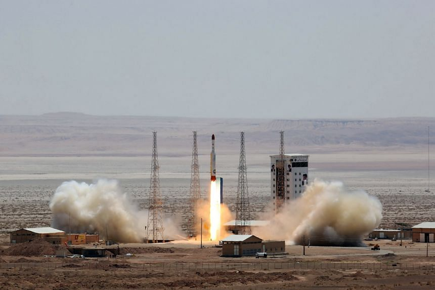 A handout picture released by Iran's Defence Ministry shows a Simorgh (Phoenix) satellite rocket at its launch site at an undisclosed location in Iran.