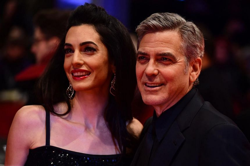 George Clooney (right) and his wife Amal arrive at the 66th Berlinale Film Festival in Berlin.