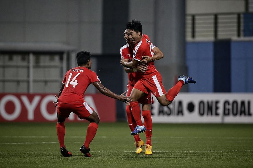 Home United midfielder Song Ui Young (right) celebrating with Afiq Yunos and Shamil Sharif after scoring the equaliser against Global FC on May 30, 2017.