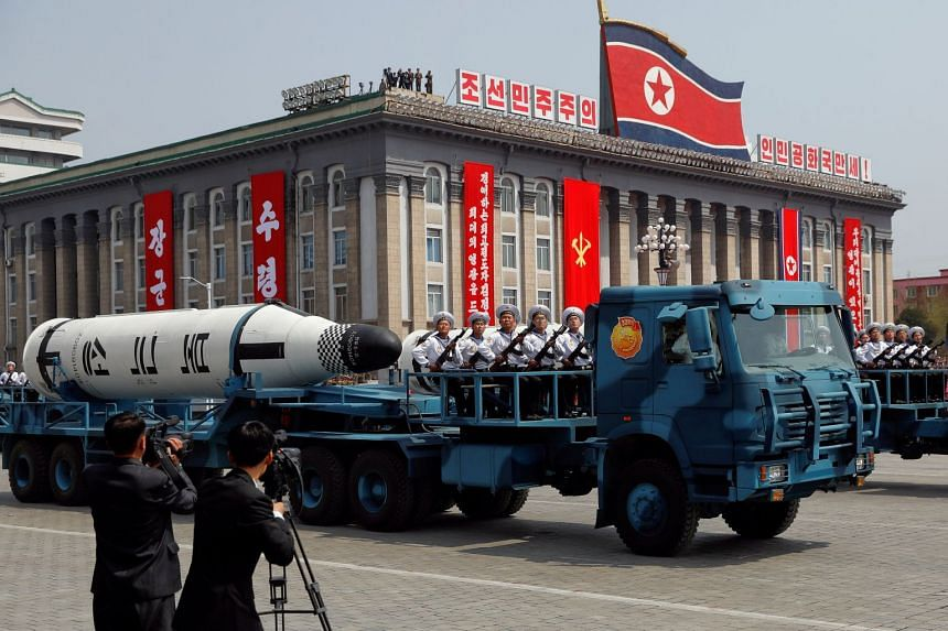 A North Korean navy truck carries the Pukkuksong submarine-launched ballistic missile (SLBM) during a military parade on April 15, 2017.