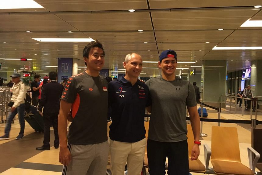 Joseph Schooling and Quah Zheng Wen pose for a photo with head coach Stephan Widmer upon their arrival at Changi Airport on Tuesday (Aug 1).
