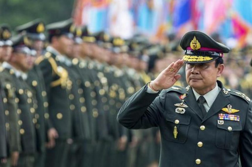 Thailand's Prime Minister Prayuth Chan-o-cha salutes members of the Royal Thai Army after a handover ceremony for the new Royal Thai Army Chief at the Thai Army Headquarters in Bangkok.