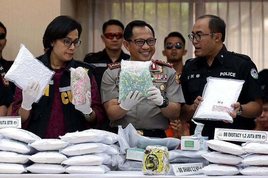 (From left) Indonesia's Finance Minister Sri Mulyani Indrawati, national police chief General Tito Karnavian and Criminal Investigation Department narcotics division head Eko Daniyanto at a press conference yesterday announcing the seizure of at leas