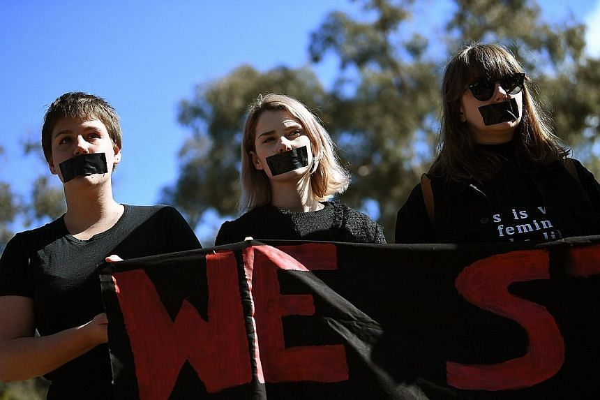 Australian National University students in Canberra protesting against sexual harassment yesterday, after a report on the problem was released.