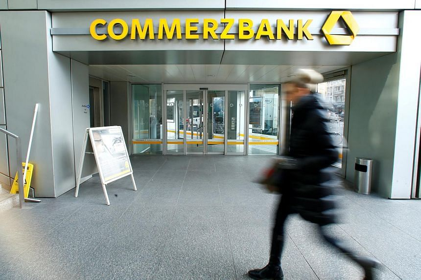 A woman walks past a branch of Commerzbank in Frankfurt, Germany, on Feb 9, 2017.