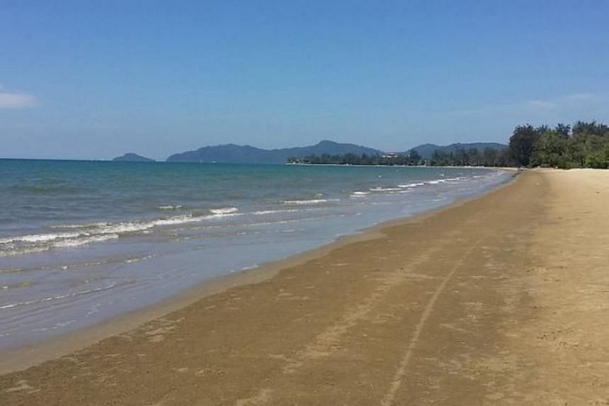 Malaysian officials are warning people heading to beaches such as the popular Tanjung Aru (pictured) should be extra careful about jellyfish.