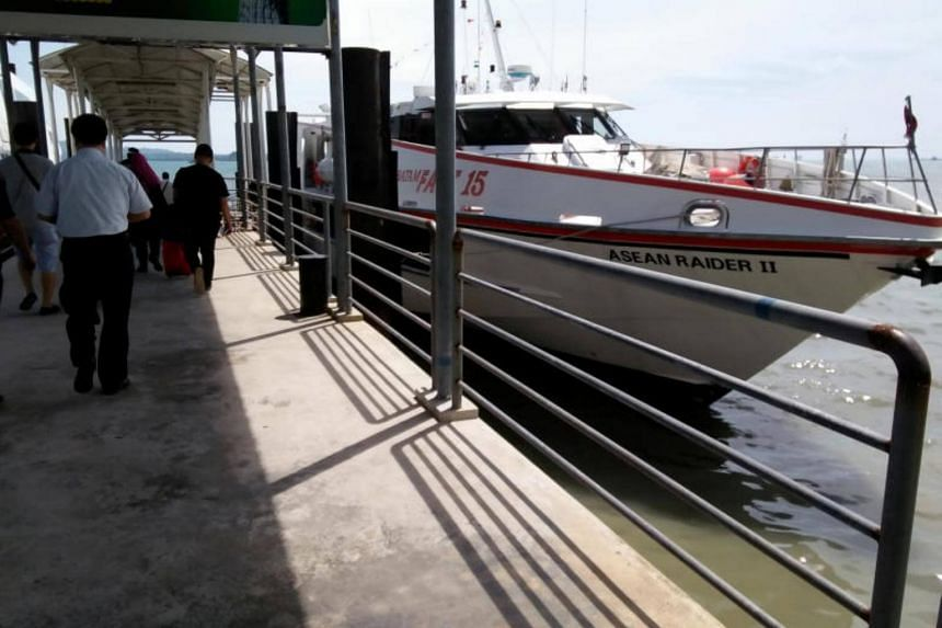 People taking the ferry at Harbour Bay terminal in Batam, Indonesia.