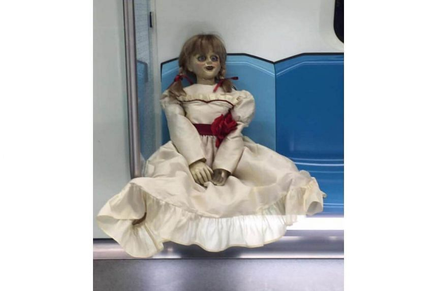 """The pictures came with the caption: """"Dear valued customers, lately we've been receiving surprise visits from Annabelle. Mind your manners while you are on our trains or… she will haunt you FOREVER."""""""