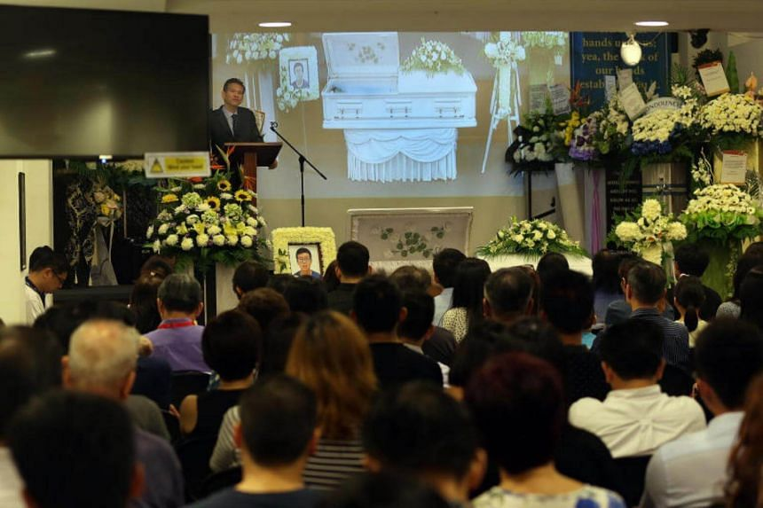 Pastor Davy Sim speaking at the wake of his son Benjamin at the Singapore Bible Baptist Church on Aug 2, 2017.