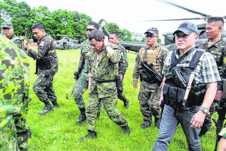 Philippine President Rodrigo Duterte arrives at the military camp in Marawi city, southern Philippines on July 20, 2017.