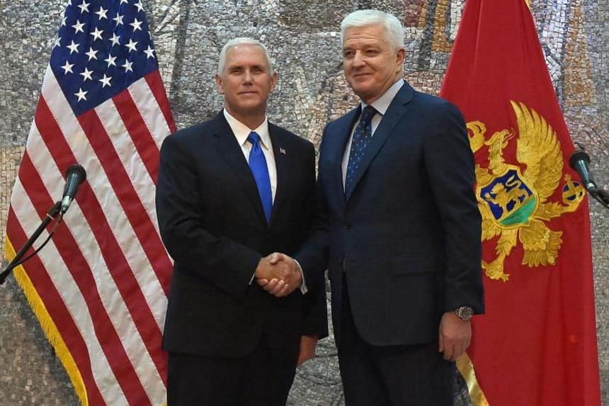 US Vice President Mike Pence (left) and Montenegrian Prime Minister Dusko Markovic (right) shake hand during a press conference in Podgorica, Montenegro on August 2, 2017.