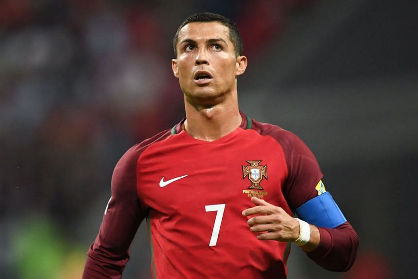 Ronaldo (above) is accused of evading 14.7 million euros (S$23.5 million) in tax.