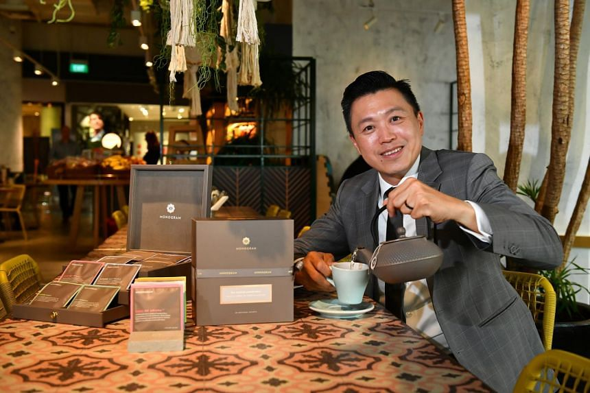 Mr Lim Tian Wee, founder of Gryphon Tea Company, posing with the new range of teas called Monogram.