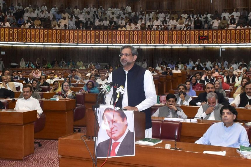 Khaqan Abbasi (centre) speaks at the Parliament House in Islamabad, on Aug 1, 2017.