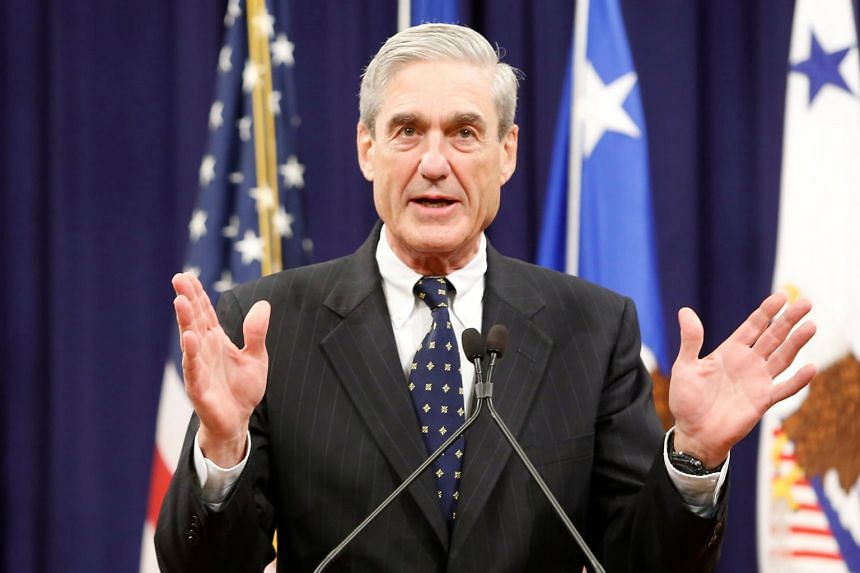 FBI Director Robert Mueller reacts to applause from the audience during his farewell ceremony at the Justice Department in Washington, DC, on Aug 1, 2013.