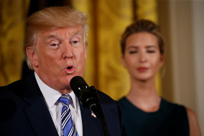 US President Donald Trump is flanked by White House Senior Advisor Ivanka Trump as he addresses an event with small businesses, on Aug 1, 2017.