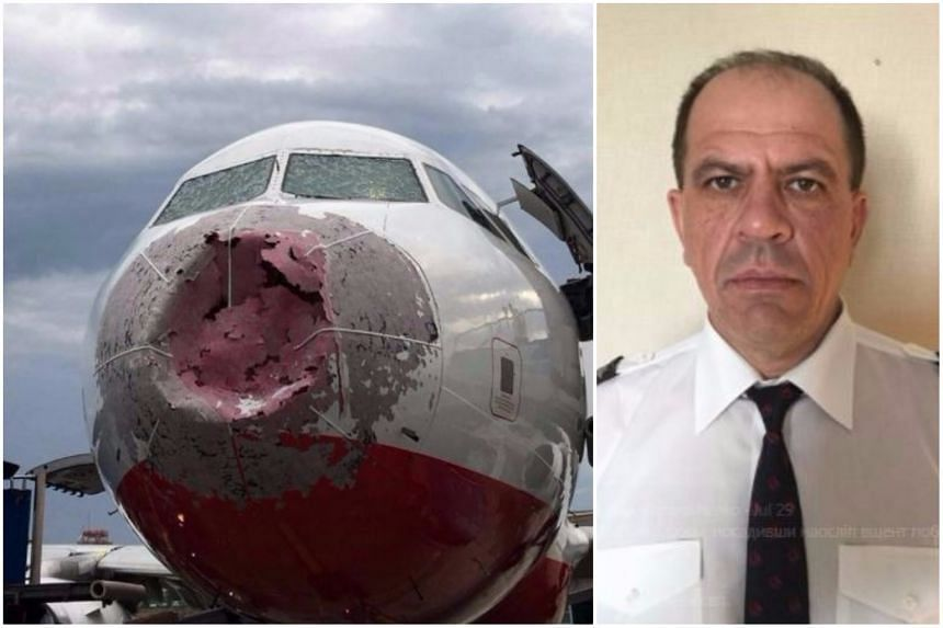 "Captain Alexander Akopov (right) had to land the passenger plane - with 127 people on board - ""blind"" after a freak hailstorm damaged its windscreen."