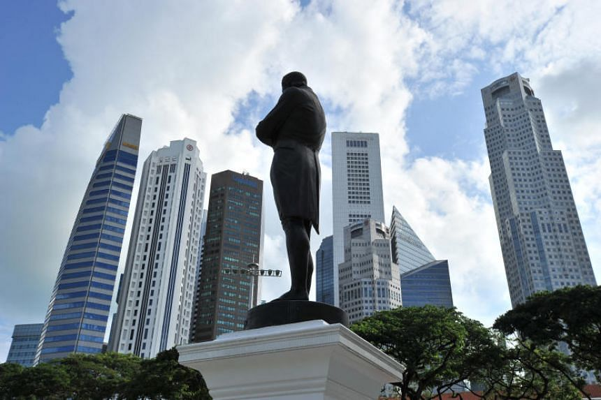 Singapore skyscapers at Battery Road, with the statue of Sir Stamford Raffles seen at the foreground.