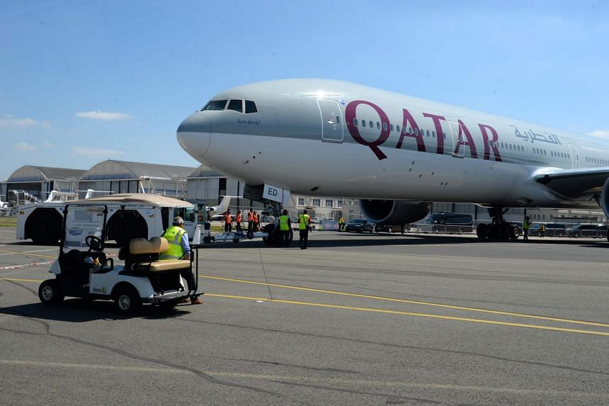 A Qatar Airways Boeing 777-300 is moved on the Tarmac of Le Bourget airport on June 18, 2017 on the eve of the opening of the International Paris Air Show.