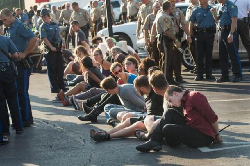 Police arrest more than 50 demonstrators who blocked traffic on Interstate 70 outside of Ferguson to mark the one-year anniversary of the shooting of Michael Brown on August 10, 2015 near Earth City, Missouri.