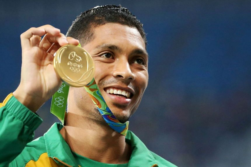Wayde van Niekerk poses with his Olympic gold medal for the men's 400m.
