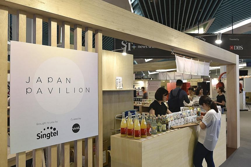 Exhibitors setting up their booths and products in preparation for the start of the Singapore Coffee Festival today. The first day is for trade members and the media, while the event will be open to the public from Friday to Sunday.
