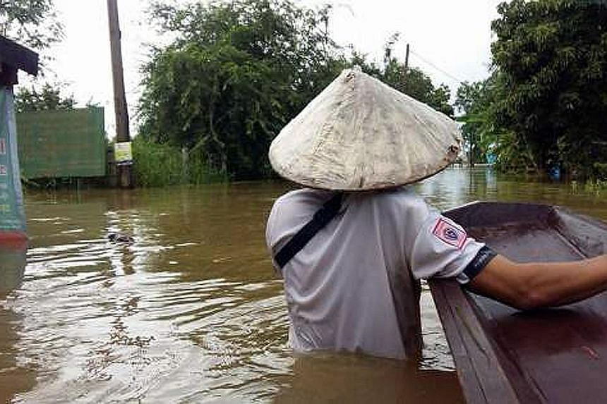 Tambon Tha Rae, Muang district, in the hardest-hit province of Sakon Nakhon. Ten provinces are still battling severe floods as rain continues to lash the upper part of the north-east.
