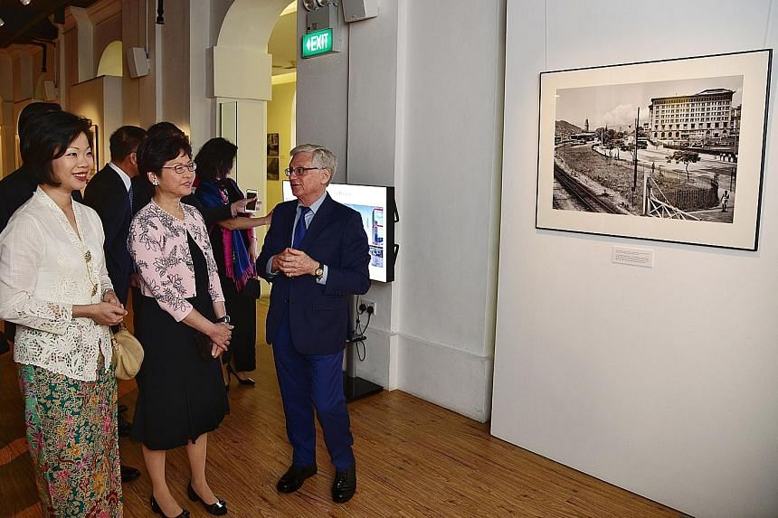 Mr Lee Fook Chee selling photos at The Peak in Hong Kong. Mr Edward Stokes, who discovered Mr Lee Fook Chee's collection of vintage photos, with Hong Kong Chief Executive Carrie Lam (second from left) and Ms Sim Ann, Senior Minister of State for Cult