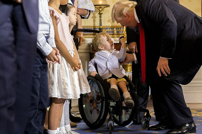 Author J.K. Rowling had wrongly accused United States President Donald Trump of ignoring Montgomery Weer (both above), a three-year-old boy with spina bifida, at the White House last month.