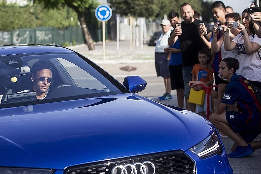 Brazil international forward Neymar arriving at Barcelona's training ground, before informing his team-mates and the club about his intention to leave the Nou Camp. PSG are set to smash the world-record football transfer fee for the star, with his bu
