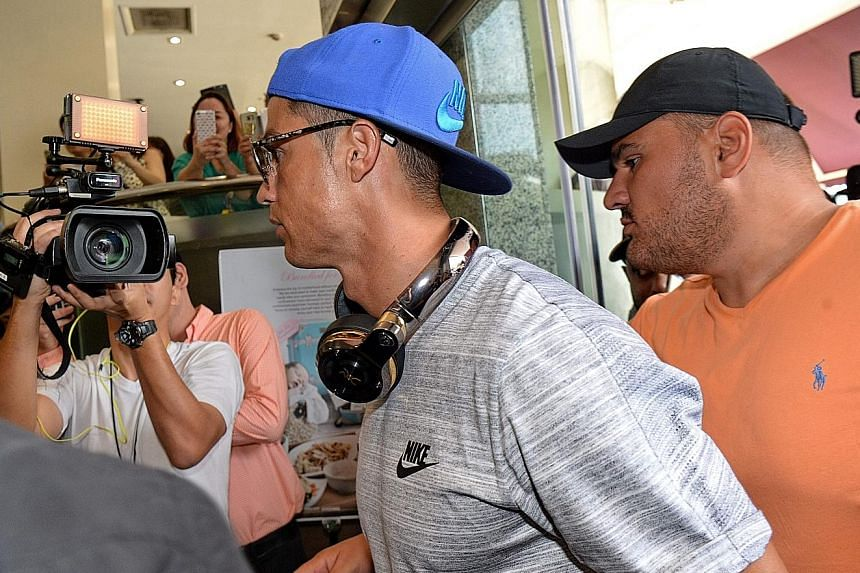 Global superstar Cristiano Ronaldo (centre) arriving at Thomson Medical Centre during a trip to Singapore last month.