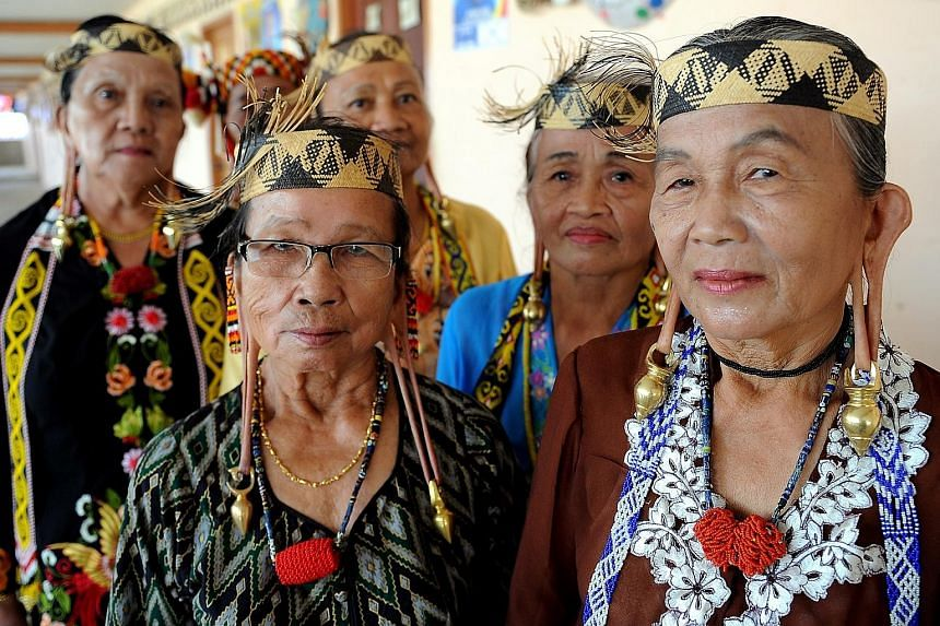 Malaysia's bumiputera include (above) the Orang Asli from the Jahai tribe, the Malays (far left) and the Kayans from Sarawak (left).