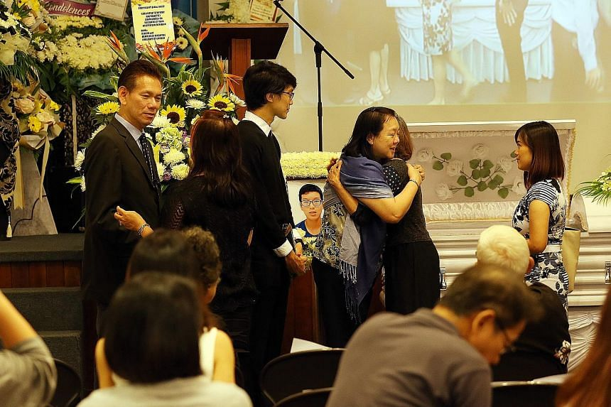(From left) Benjamin's father, Pastor Davy Sim, brother and mother at the 16-year-old's wake at the Singapore Bible Baptist Church. More than 300 people turned up yesterday to pay their respects.