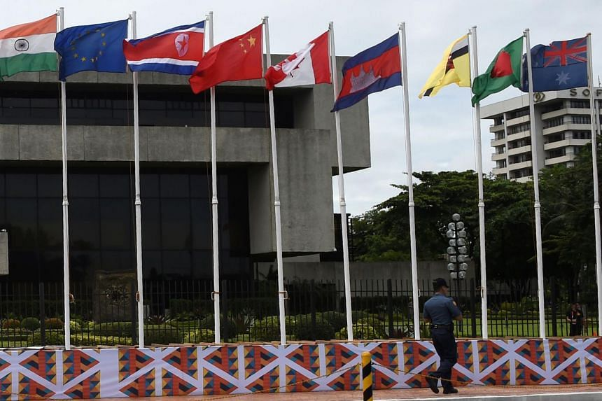 National flags, including that of North Korea (third from left), are seen in front of the venue of the Association of Southeast Asian Nations (ASEAN) Regional Forum (ARF) meeting in Manila on Aug 3, 2017.