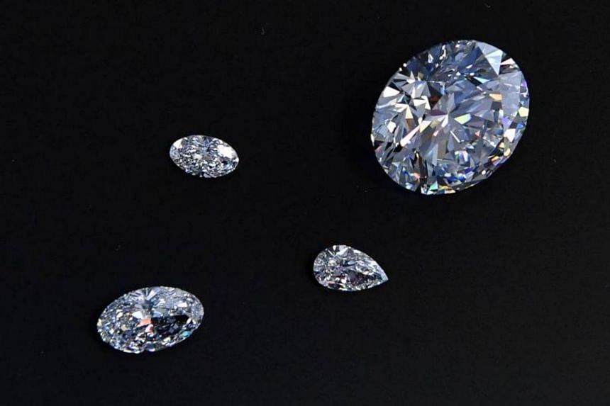 A view of the main 51.38-carat round-cut diamond, the Dynasty, among other gems from Russian diamond miner Alrosa's Dynasty polished diamonds collection in Moscow on Aug 3, 2017.