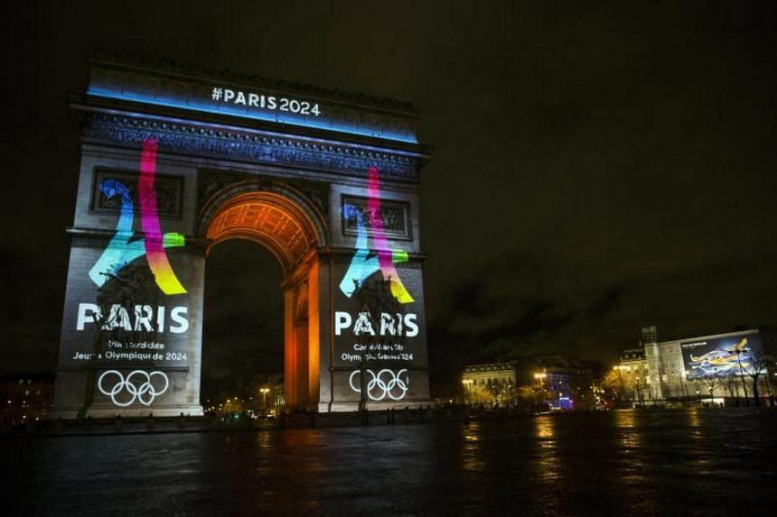 The Arc de Triomphe displays the 2024 Paris olympics logo in Paris, France.