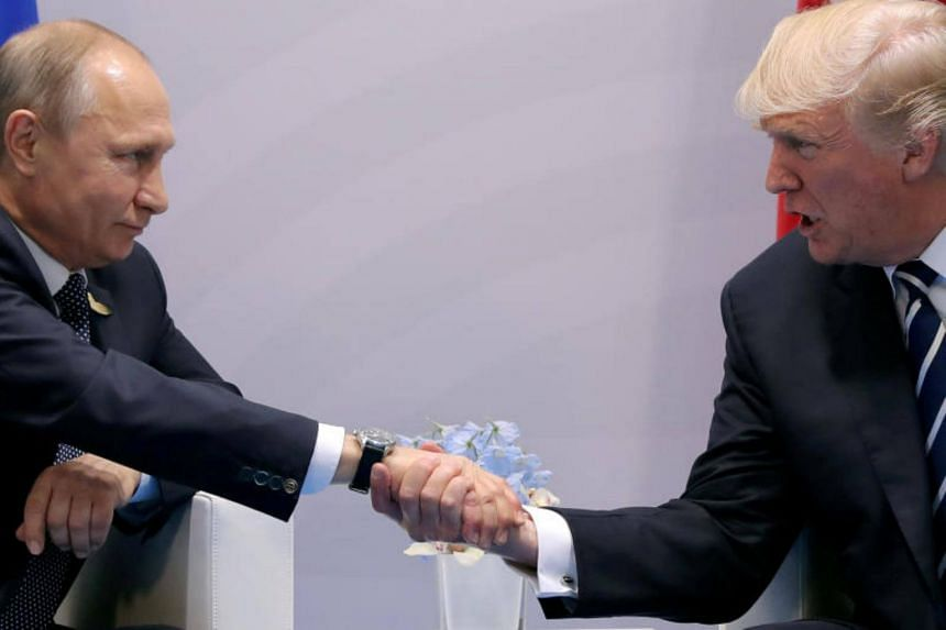 US President Donald Trump shakes hands with Russian President Vladimir Putin during the their bilateral meeting at the G20 summit in Hamburg, Germany on July 7, 2017.