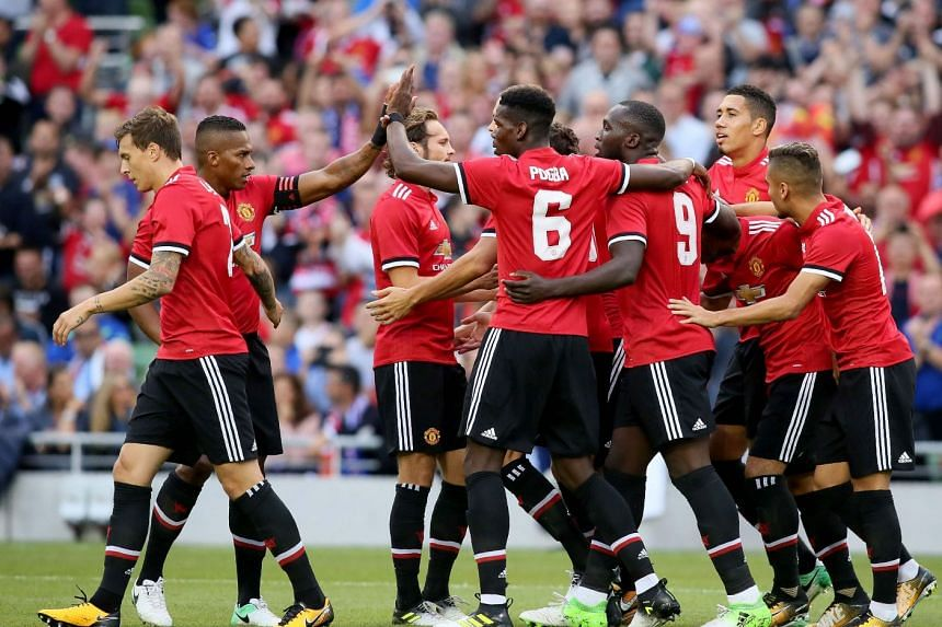 Manchester United players celebrate their first goal scored by Henrikh Mkhitaryan during the pre-season friendly game between Manchester United and Sampdoria.
