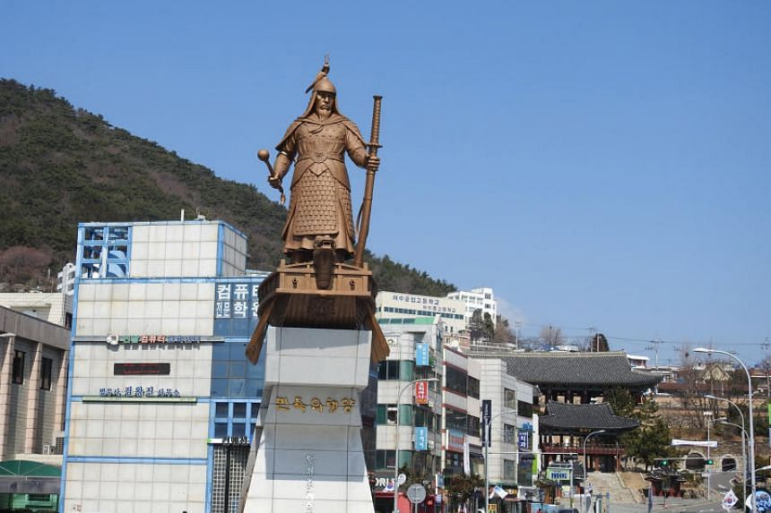 A statue of Admiral Yi Sun Sin stands tall at a plaza named after him in Yeosu, where he spent many years building a strong naval force.
