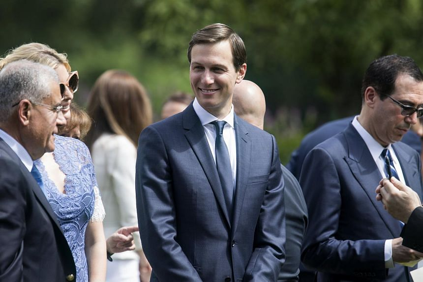 Senior Advisor Jared Kushner (centre) greets guests before listening to US President Donald Trump and Prime Minister Saad Hariri of Lebanon speak to reporters in the Rose Garden of the White House.