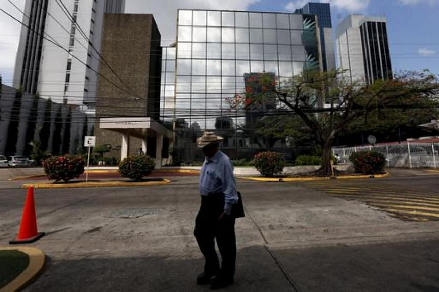 A man walks pass the Arango Orillac Building where the Mossack Fonseca law firm is situated at, in Panama City, on April 4, 2016.