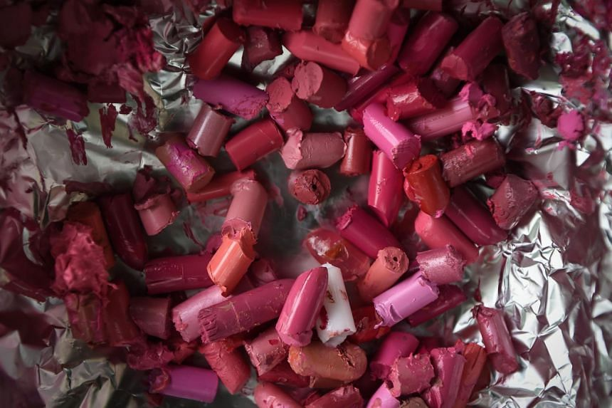 Recycled tubes of lipstick ready to be melted over a stove in Bangkok.