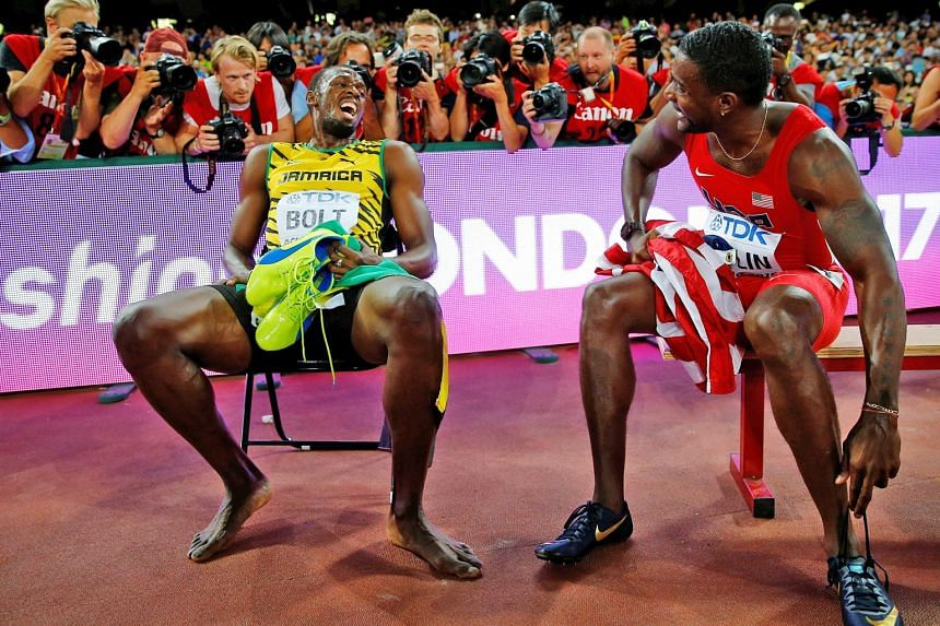 Usain Bolt of Jamaica chatting with American Justin Gatlin after the 200m final at the 2015 World Championships in Beijing. Bolt won the race, with Gatlin finishing second. The duo are expected to battle for the 100m world crown on Saturday.