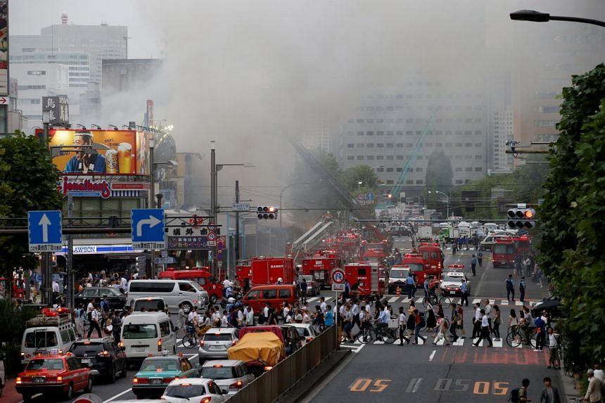Firefighters operate at the fire site at Tokyo's Tsukiji fish market in Tokyo, Japan on Aug 3, 2017.