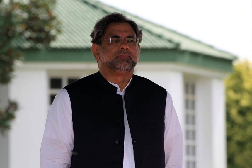 Pakistan's Prime Minister Shahid Khaqan Abbasi reviews the honour guard in Islamabad, Pakistan,  on Aug 3, 2017.