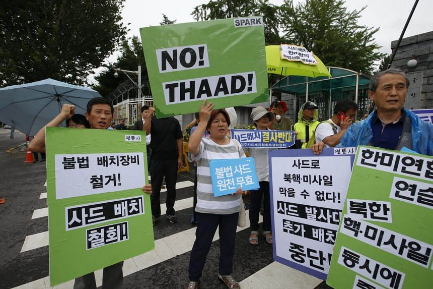 South Korean protesters and Seongju-gun residents shout slogans and held banners reading 'No THAAD' during a rally against the South Korean and US Government's defense policy in front of the Ministry of National Defense in Seoul, on July 31, 2017.