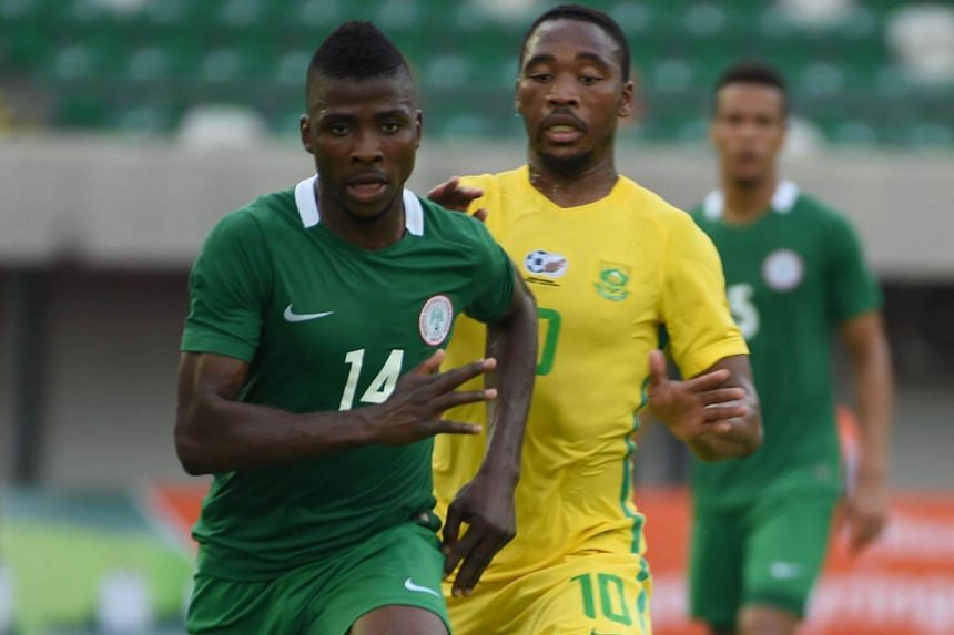 Nigerian attacker Kelechi Iheanacho (left) controls the ball during the 2019 African Cup of Nations qualifier football match between South Africa and Nigeria at Goodswill Akpabio International Stadium in the southern city of Uyo, on June 10, 2017.