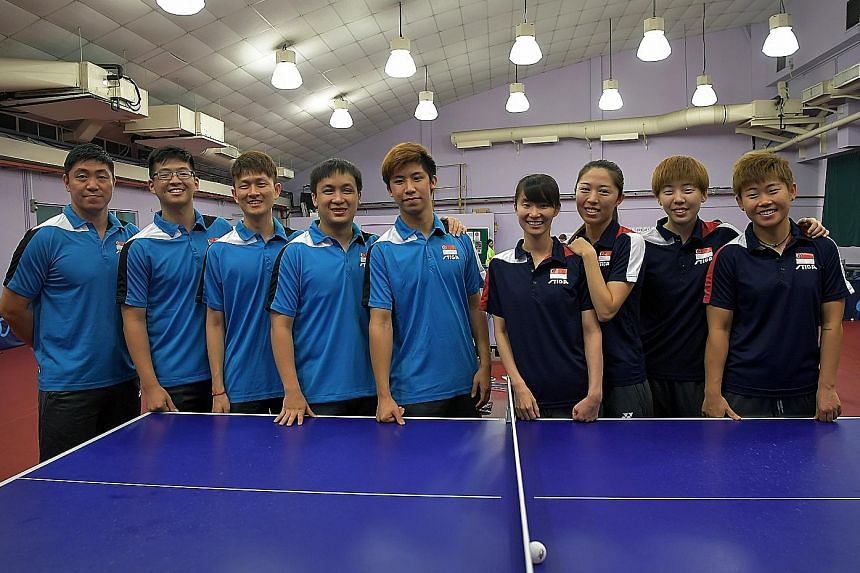 The Singapore table tennis team at a press conference held at the STTA Lee Kong Chian training hall yesterday. They won six of seven golds at the 2015 SEA Games and will hope for a sweep in Kuala Lumpur this month.